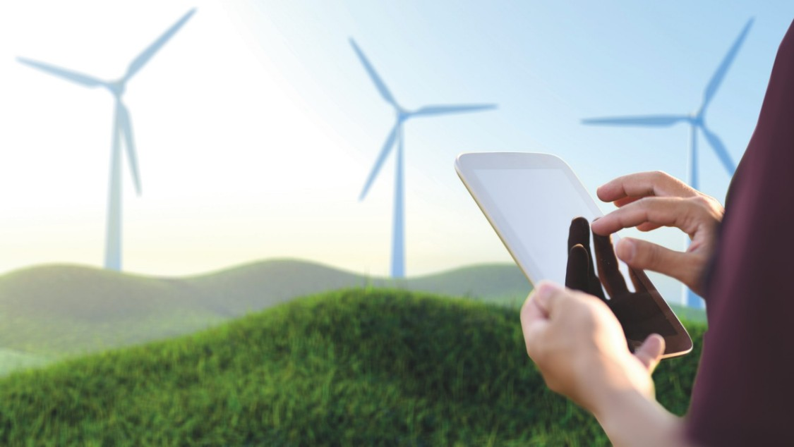Engineer using a digital tablet for the operation of a wind turbine