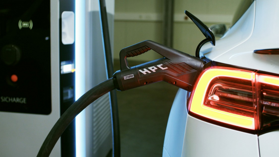 Close up picture of an electric car charging situation