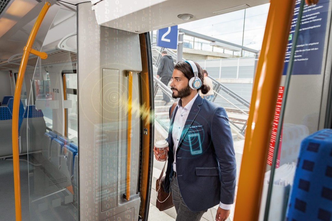 Man entering a train door with phone in pocket communicating to the system