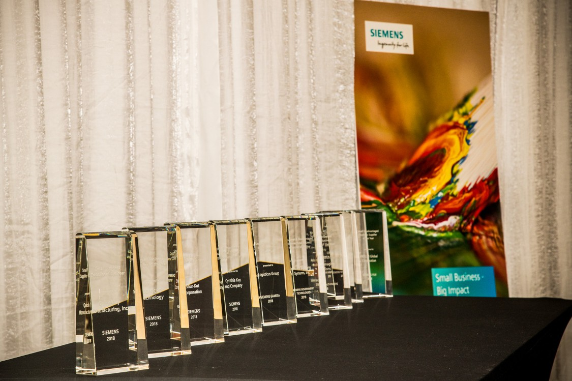 Table with Recognition Award Trophies displayed for Siemens Supplier Diversity Award 2019s