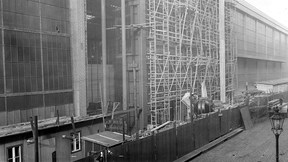 Production was uninterrupted until late in the construction project, when the original hall and new extension were joined together, 1941
