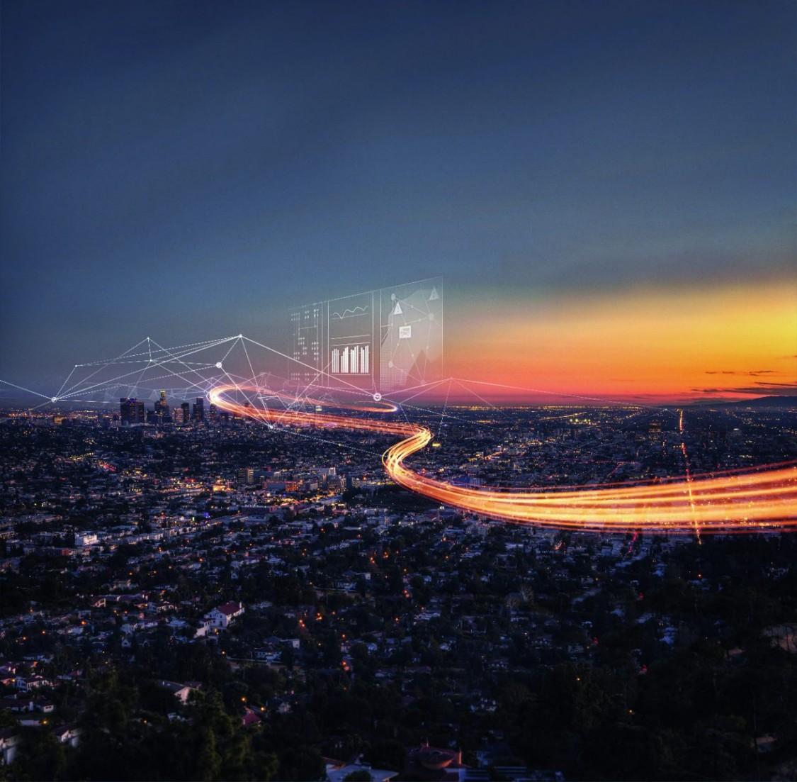 imagem aérea de uma estrada com caminhos de luzes representando a distribuição de energia