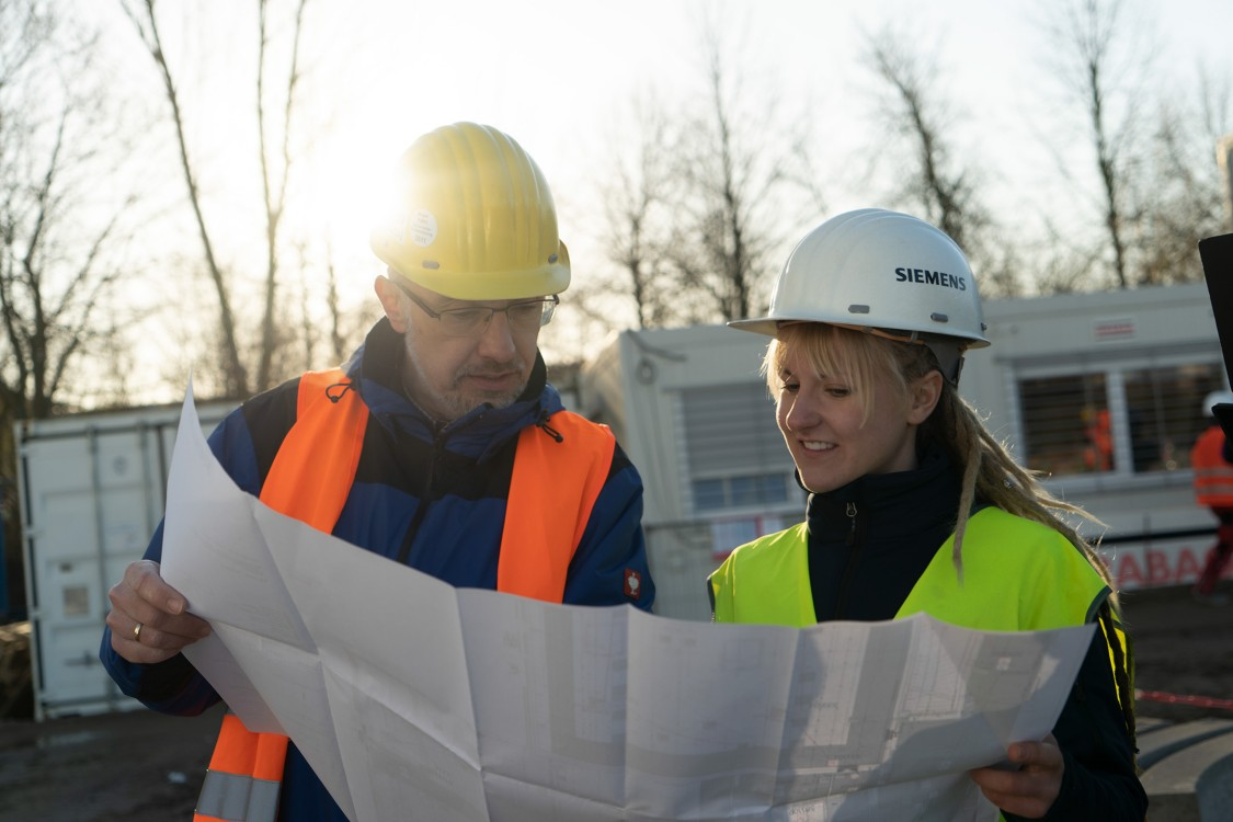 Male and female engineers consulting on a project