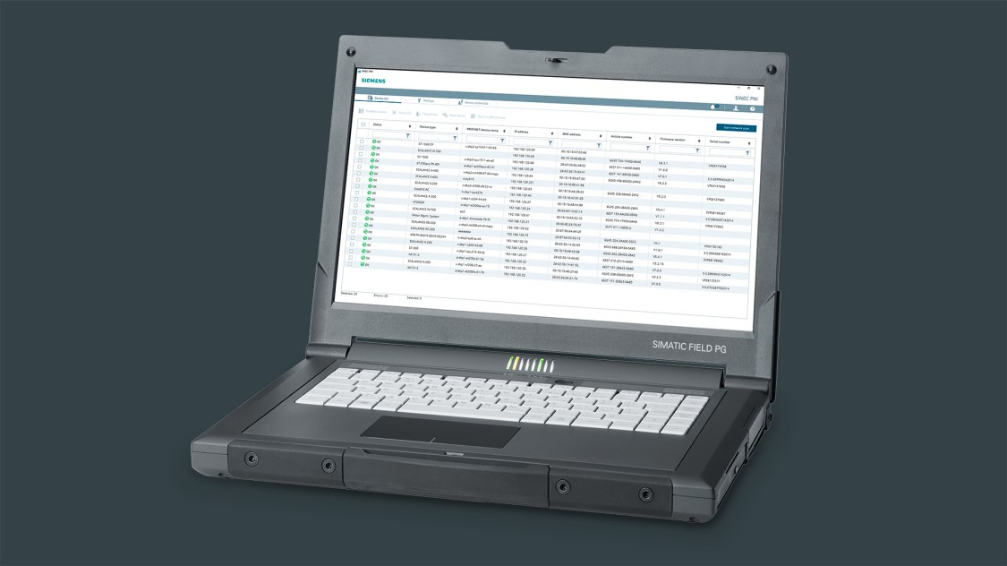 An opened laptop in the diagonal view shows the SINEC PNI user interface.