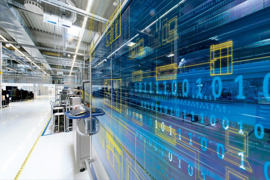 galpão industrial de fabricação de produtos siemens com filtros azuis e amarelos representando a inovação do catálogo siemens no brasil